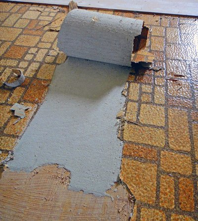 Asbestos floor tiles being removed